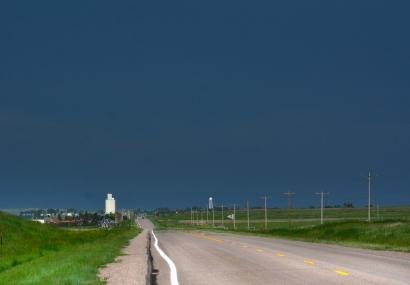 silo in distance under black sky
