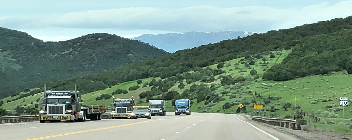 snow on mountains trucks